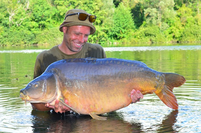 Dean with the Troll at 64lb 8oz