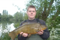 A wonderful, olive green tench weighing 7lb 9oz