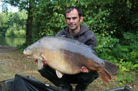 At 39lb 10oz, this big mirror was worth getting bruise for