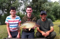 Martin Pick with his students and a Manor Farm carp