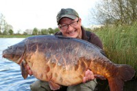 Danny holds up one of the best looking carp in the UK
