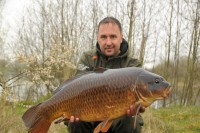 Vitalii holding his first carp from the UK