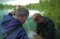 Barty helping a client with another Gigantica beast