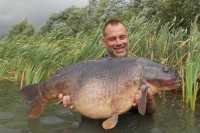Once in the water, Jon hoists 37lb 13oz of beautiful carp aloft