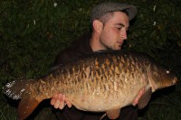 Under the moonlight, Josh weighed the scaly beast
