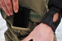 You'll find a hidden pouch for your phone in the thigh pockets
