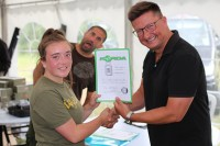 Phoebe receiving her certificate