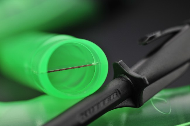It works as baits are forced over this safely hidden blade.